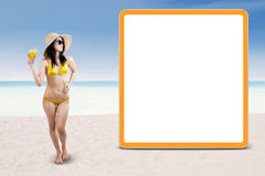 Sexy woman with empty board at beach Stock Photo