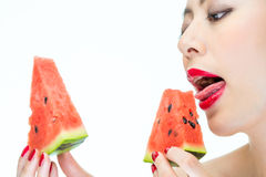 Sexy woman enjoy eating watermelon with red lips, Greedy, Lickin Royalty Free Stock Image