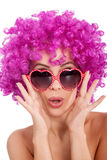 Sexy woman with fancy glasess and pink wig Stock Image