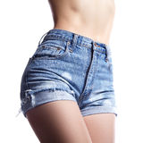 Sexy woman in fashion blue jeans shorts. Perfect hot booty and erotic curves hips. Good body shapes whithout cellulite. Sport and diet Stock Photos