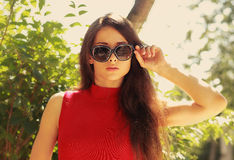 Sexy woman in fashion sunglasses looking Stock Images