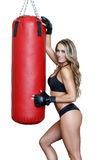 Sexy woman fighter with heavy bag Royalty Free Stock Photos