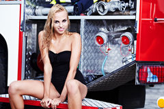 woman and fire truck Stock Photos