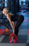 Sexy woman flexing muscles with barbell in gym.  Royalty Free Stock Photos