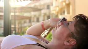 Sexy Woman Flirting on a Sunny Beach, Wears Sunglasses At Summer Resort stock video footage