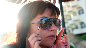 Sexy Woman Flirting on a Sunny Beach, Wears Sunglasses At Summer Resort stock video