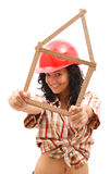 Sexy woman with folding rule. Sexy young repair woman in helmet with a folding rule in her hand in form of house Stock Photo