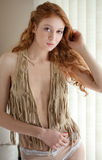 Sexy Woman in Fringe Vest. An image of an attractive young woman in a fringed vest and panties Royalty Free Stock Photos