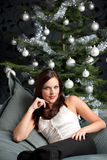 woman in front of Christmas tree Stock Photo
