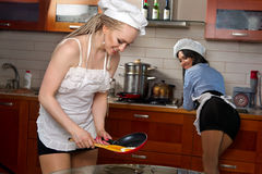 woman frying eggs Stock Image