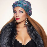 Sexy woman in fur and arabic turban Royalty Free Stock Images