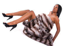 Sexy woman in fur blanket. Stock Photo