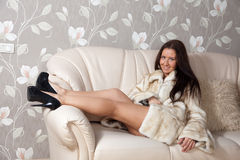 Sexy woman in fur coat Stock Images