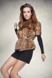 Sexy woman in a fur coat Stock Photos