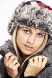 Sexy woman in fur hat - dragan version. Studio portrait Stock Images