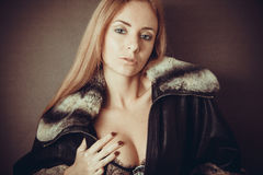 Sexy woman in fur neckpiece Royalty Free Stock Photography