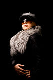 Sexy woman with furr and sunglasses Royalty Free Stock Images