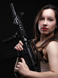 Girl holding Rifle on black background Royalty Free Stock Images