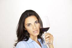 Sexy woman with a glass of red wine Royalty Free Stock Images