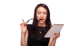 Sexy woman in glasses with notepad Royalty Free Stock Photography