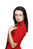 Woman in glasses and red suit holding whip. Isolated on white, bdsm stock images