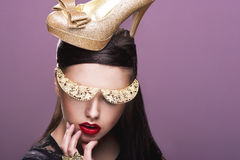 Sexy woman with gold shoe Royalty Free Stock Photography