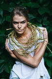 Sexy woman with golden necklace on nature Royalty Free Stock Photo