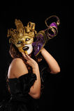 Sexy woman in golden party mask Stock Photos