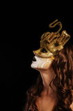 Sexy woman in golden party mask Royalty Free Stock Photos