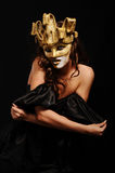 Sexy woman in golden party mask Royalty Free Stock Photography
