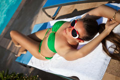 Sexy woman in green bikini enjoying the sunset Royalty Free Stock Photography