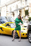Sexy woman in green dress and super car. Full growth,  beautiful young woman in green dress Stock Images