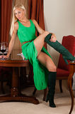 Sexy woman in a green dress with a wine glass Royalty Free Stock Photo