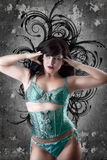 Sexy woman with green lingerie over artistic background Stock Photography