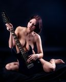 Sexy woman with guitar Royalty Free Stock Photo