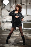 Sexy woman with gun Royalty Free Stock Images