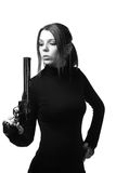 Sexy woman with a gun Stock Photography
