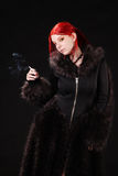 Sexy woman with a gun Royalty Free Stock Images