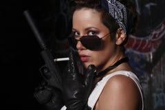 Sexy woman with a gun. Stock Photos