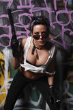 Sexy woman with a gun. Stock Photography