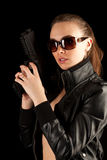 Sexy woman with guns Royalty Free Stock Images