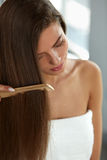 Woman With Haircomb In Hand Hairbrushing. Hair Health Royalty Free Stock Image