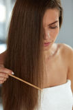 Woman With Haircomb In Hand Hairbrushing. Hair Health Royalty Free Stock Photography