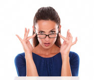 Sexy woman with hand on glasses looking at you Royalty Free Stock Photography