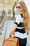 Sexy woman with handbag wearing sunglasses Royalty Free Stock Image