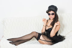Sexy woman with handcuffs in fashion glasses Stock Image