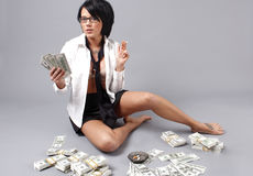 Sexy woman handling lots of cash Stock Photos