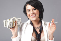 Sexy woman handling lots of cash Stock Image