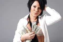 woman handling lots of cash Stock Images