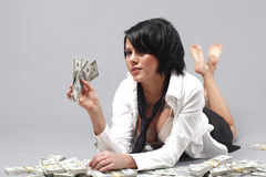 Sexy woman handling lots of cash Royalty Free Stock Image